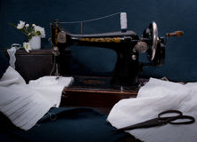 Classic retro style manual sewing machine ready for  work, scissors, fabric and old Stock Image