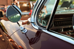 Classic retro vintage black car. Car mirror. The car is older than 1985 stock photos
