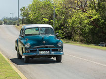 classic, retro vintage taxi car driving on the road in Cuba Stock Photos