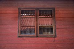 Classic retro vintage window on wall of wooden hut in Chaiyaphum, Thailand royalty free stock photo