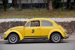 Classic retro yellow car Volkswagen Beetle on the road Royalty Free Stock Photography