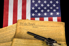 Classic revolver with the flag and constitution Royalty Free Stock Images