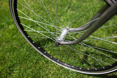 Classic road bicycle close-up photo in the summer green grass meadow field. Travel background Stock Image