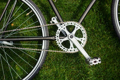 Classic road bicycle close-up photo in the summer green grass meadow field. Travel background Royalty Free Stock Image