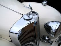Classic Rolls Royce. Classic white rolls royce with the famous flying lady emblem / mascot royalty free stock photo