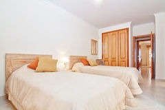 Classic room with a toilet and a bedroom wardrobe. Royalty Free Stock Photos