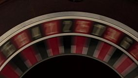 Classic roulette spinning fast black background stock video footage