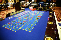 Classic roulette. Table with chips and information monitor Royalty Free Stock Photos