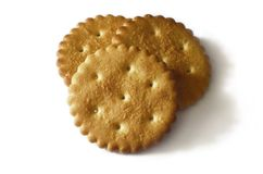Classic round golden yellow salted cracker isolated on over white backgroun. D stock photo