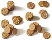 Classic round golden yellow salted cracker isolated on over white backgroun. D royalty free stock image