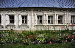 Classic Russian Estate, Russia. Flowers embrace the windows of a traditional Russian residence outside Moscow Stock Photo