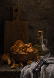 Classic rustic still life with chanterelles. On the rough wooden background royalty free stock images