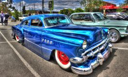 Classic 1950s American Chevy. Classic 1950s blue Chevy that`s been lowered and custom painted at car show in Melbourne, Australia Royalty Free Stock Photos
