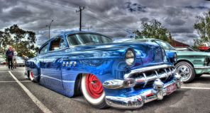 Classic 1950s American Chevy. Classic 1950s blue Chevy that`s been lowered and custom painted at car show in Melbourne, Australia Royalty Free Stock Images