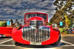 Classic 1930s American Chevy pickup truck. Classic 1939 red American Chevy pickup truck on display at car show in Melbourne, Australia Royalty Free Stock Images