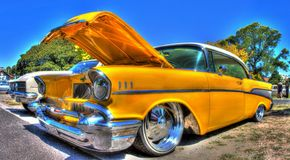 Classic 1950s American Chevy. Classic 1957 American yellow Chevrolet sedan car on display at a car show in Melbourne, Australia Stock Images