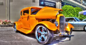 Classic 1930s American Ford. Classic 1930s American yellow Ford sedan car on display at a car show in Melbourne, Australia Royalty Free Stock Photo
