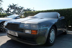 Classic 80s aston martin sports car headlamps hood. Side detail aston martin v8 zagato front quarter view Royalty Free Stock Image