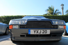 Classic 80s british sports car headlamps and grill. Double headlamp and grill full front view detail aston martin v8 zagato Stock Images