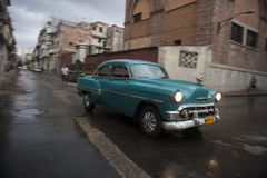 Classic 50s Car Drives in Centro Havana Cuba Royalty Free Stock Images