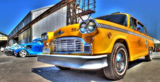 Classic 1970s Checker taxi. Classic 1970s American made yellow Checker taxi cab on display at a car show in Melbourne, Australia royalty free stock image