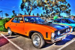 Classic 1970s Ford XA Falcon. Classic 1970s orange and black Ford XA Falcon 2 door hardtop on display at a car show in Melbourne, Australia royalty free stock photo