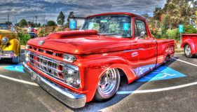 Classic 1960s American Ford pickup truck. Classic 1960s red American Ford pickup truck on display at car show in Melbourne, Australia Stock Images