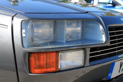 Classic 80s sports car headlamps close up. Double headlamp detail aston martin v8 zagato Royalty Free Stock Photos