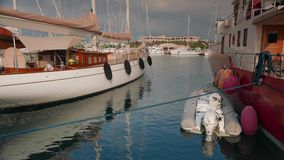 Classic sailing and motor superyachts moored in stock video