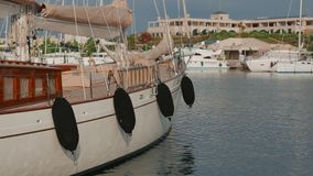 Classic sailing superyacht moored in marina, 4k stock video