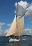 Classic sailing yacht. A classic sailing yacht in full sail Stock Image