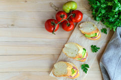 Classic sandwich with sausage and cheese on white baguette. Breakfast. Royalty Free Stock Image