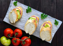 Classic sandwich with sausage and cheese on white baguette. Breakfast. Royalty Free Stock Images
