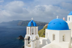 Classic Santorini scene with famous blue dome churches Royalty Free Stock Photo