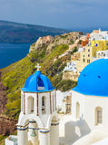 Classic Santorini scene with famous blue dome churches Stock Images