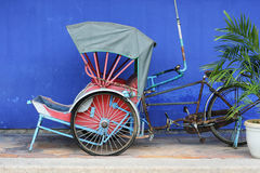 Classic scene of Old Asia. This is an old cycle rickshaw from Penang. It's a classic symbol of old Penang and Asia royalty free stock photography