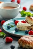 Classic scones with clotted cream, strawberries jam, english Tea and other fruit stock images