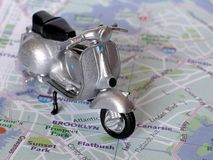 Classic Scooter. Toy on map Stock Images