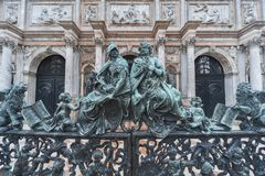 Classic sculpture in Venice, Italy. Decorative metal gate ornament. Antique iron door with classic ornaments of Campanile in Doge`s palace, Venice, Italy Royalty Free Stock Images