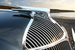 Classic by the sea. Detail of grill of vintage automobile stock photo