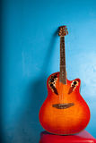 Classic semi-acoustic guitar on blue Royalty Free Stock Photography