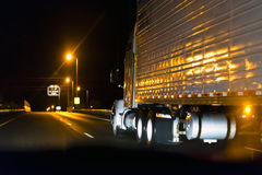 Classic semi truck on the high way in night Stock Image