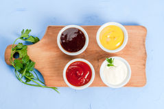 Classic set of sauces in white saucers Royalty Free Stock Image