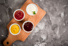 Classic set of sauces in white saucers Royalty Free Stock Photography