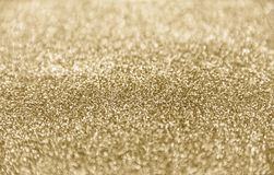 Classic shiny gold glitter background with selective focus. Classic gold glitter background - selective focus and stylish - design element stock photos