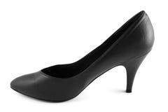 Classic shoe. Classic formal black high heel womans shoe - feminine symbol stock photos