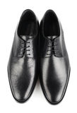 Classic shoes. Classic black leather mens shoes with laces isolated on white background top view Stock Image