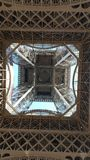 Classic shot from underneath the eiffel tower. Take on a sunny February morning without a cloud in the sky stock photo
