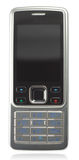 Classic silver-black cell phone. On white background with reflection with clipping path Stock Image