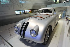Classic silver BMW 328 race car on display in BMW Museum. MUNICH - JUNE 8: Classic silver BMW 328 race car on display in BMW Museum on June 8, 2013 in Munich Royalty Free Stock Image